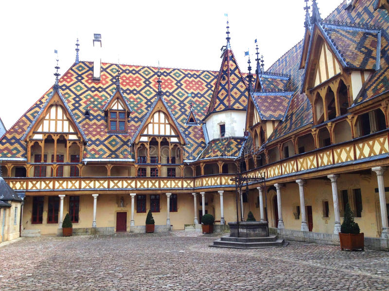 Hospices of Beaune, France. The Hospices de Beaune or Hôtel-Dieu de Beaune is a former charitable almshouse in Beaune, France royalty free stock image