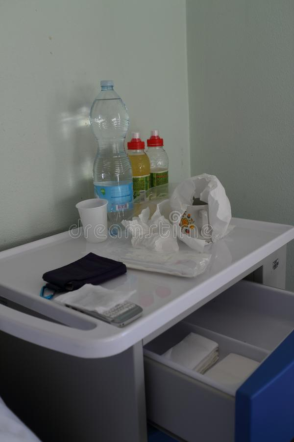 Hospital bedside table. In a real hospital room, with objects on top of the sick person royalty free stock photo