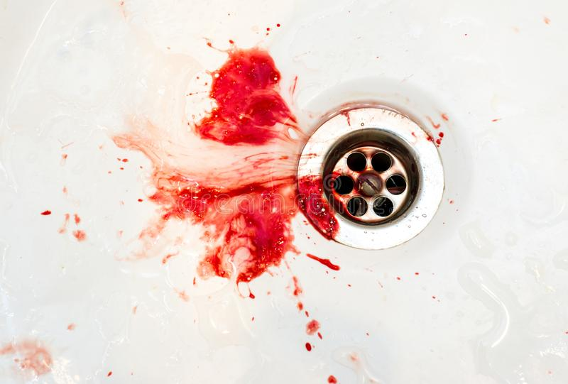 Blood in the sink. The hospital, blood in the sink stock images