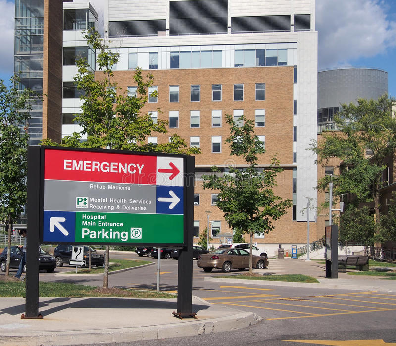 Hospital building. With emergency sign stock images