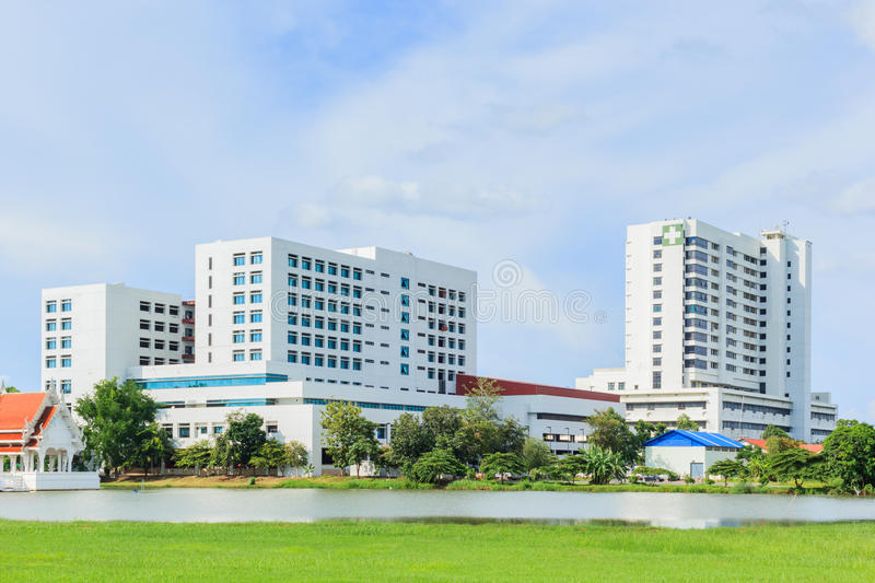 Hospital building. Modern hospital building with blue sky stock photos
