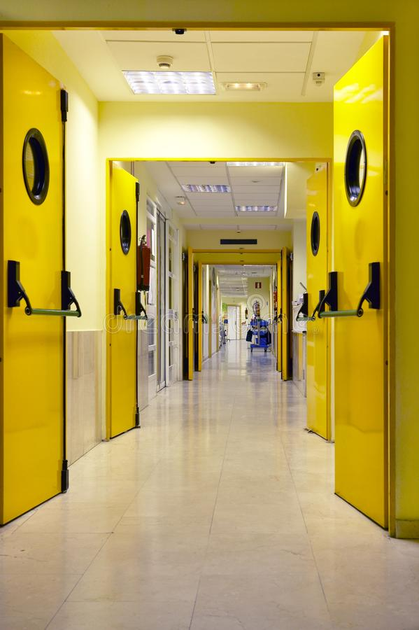 Hospital corridor indoor in yellow tone. Health center interior royalty free stock photo