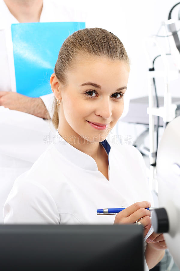 Hospital department of ophthalmology. Young attractive doctor ophthalmologist at an ophthalmologist stock image