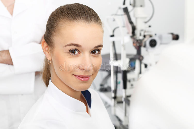 Hospital department of ophthalmology. Young attractive doctor ophthalmologist at an ophthalmologist royalty free stock image