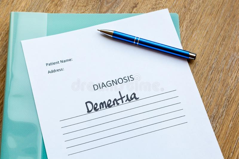 Hospital or Doctor Consultation Concept - Dementia. Dementia diagnosis written on paper with a folder and pen stock photos