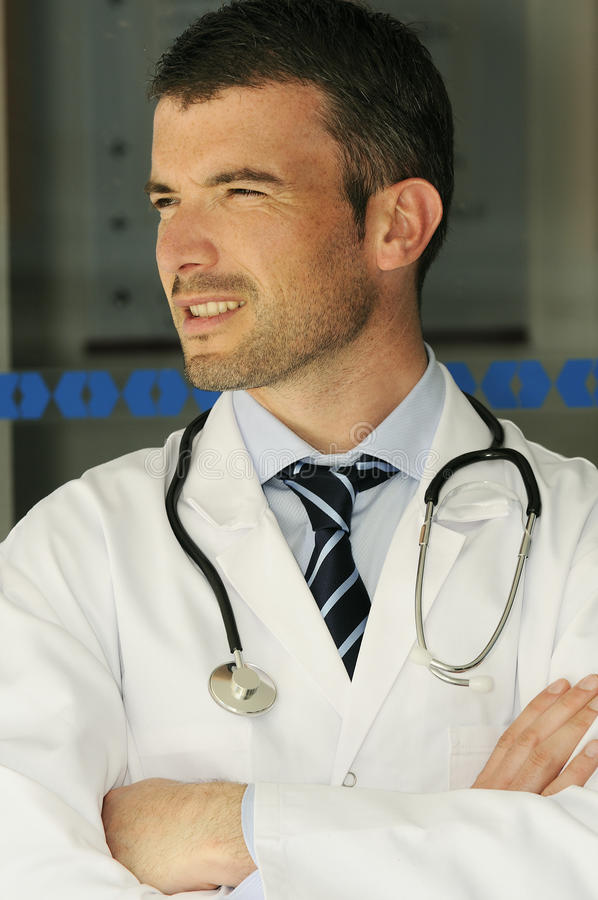 Hospital doctor emergency. Portrait of doctor in front an entrance of the hospital stock photos