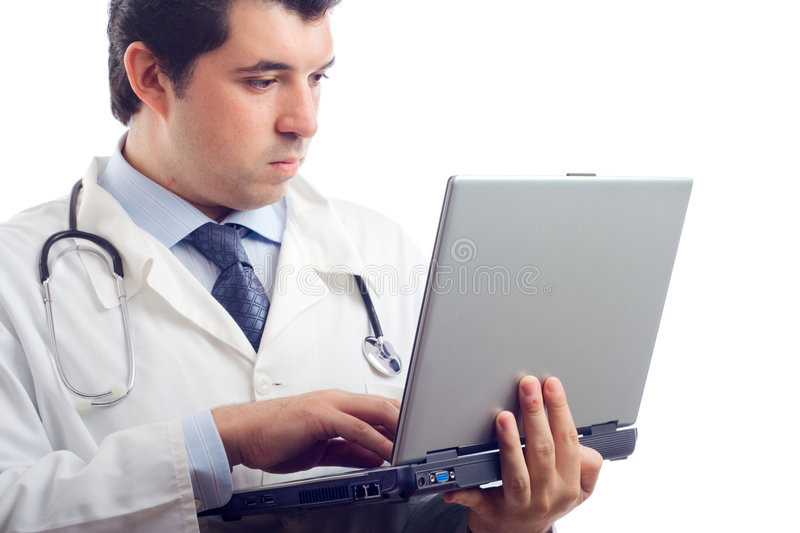Hospital doctor working on a laptop stock photos