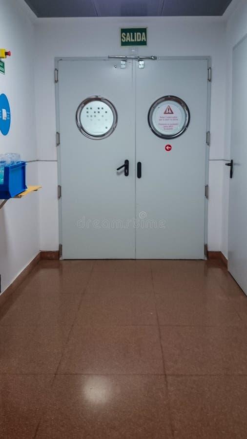 Hospital door in corridor royalty free stock photography