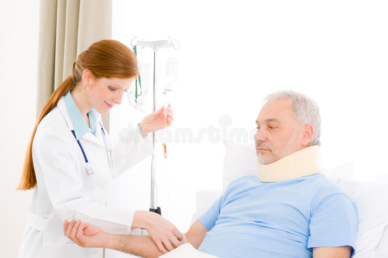 Hospital - female doctor IV drip patient royalty free stock photo