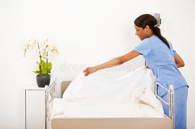 Hospital: Female Nurse Making the Bed stock images