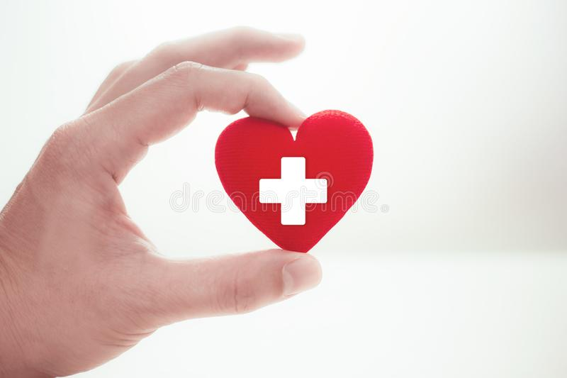 Hospital Health Care Love with Heart in Hand for Help and Donation concept stock photo