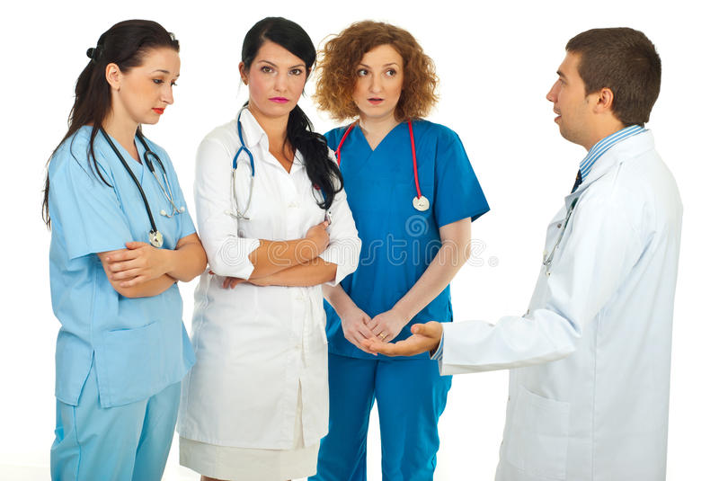 Hospital manager argue with doctors stock images