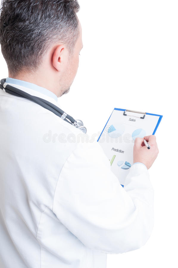Hospital manager reading financial charts and sales prediction stock image