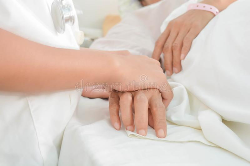 Hospital patient hands to care stock photography