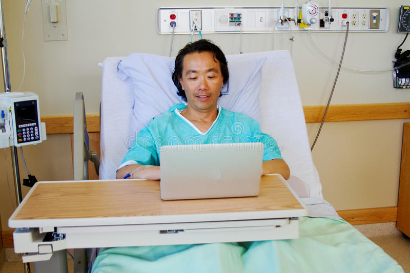 Hospital patient looking at computer stock photography