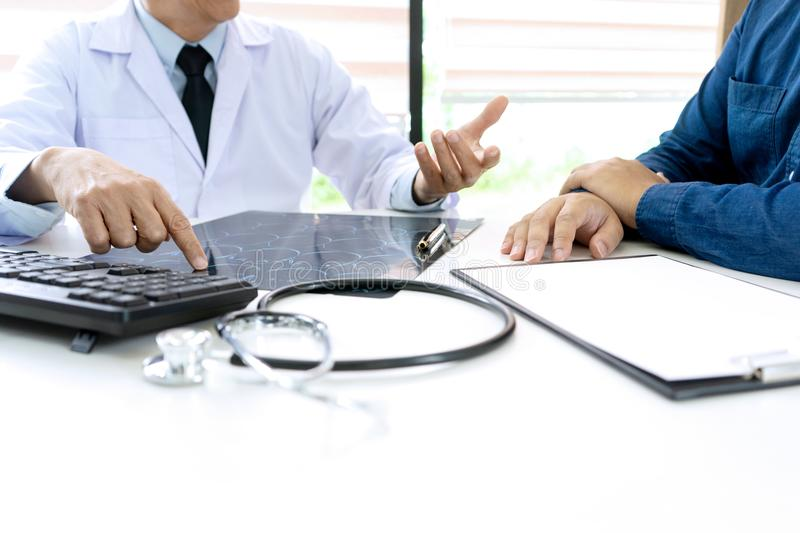 In hospital professional brain doctor give a counselor. To the patient and tell the detail to help for good health, Stethoscope Medical instruments are on the royalty free stock image