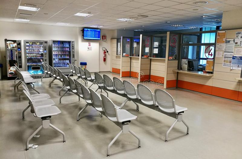 Hospital reception waiting room. Waiting room with reception and chairs in hospital building centre stock image