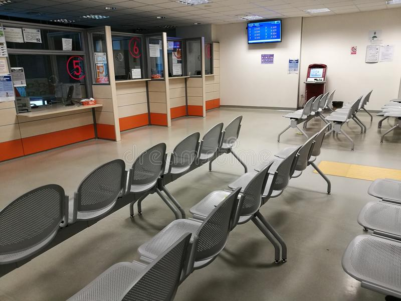 Hospital reception waiting room. Empty waiting room and hospital reception with chairs royalty free stock image
