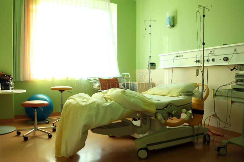 A hospital room with a bed and some equipment stock photos