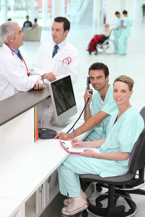 Hospital staff at the reception. Desk royalty free stock images