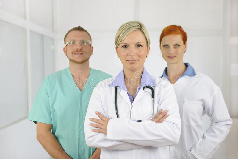 Hospital team: Doctors and surgeon royalty free stock photos