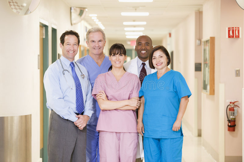 Hospital Team Standing In A Corridor stock photo