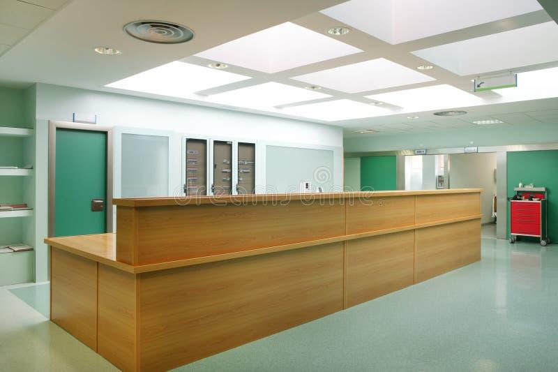 Hospital urgencies hallway indoor reception desk. Emergency services stock photos