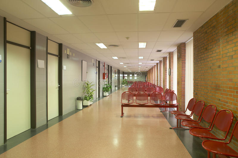 Hospital waiting area with metallic chairs. Horizontal stock photo