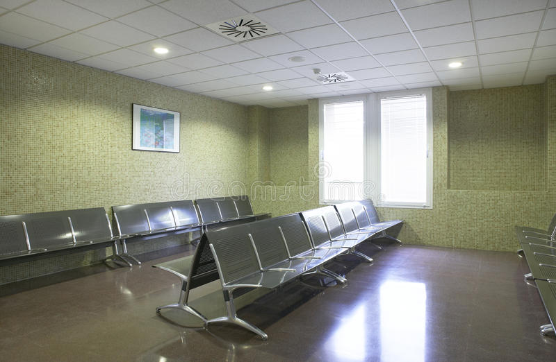Hospital waiting area with metallic chairs. Horizontal royalty free stock images