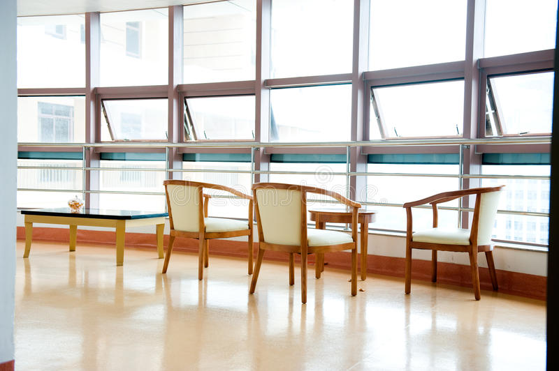 Hospital waiting room. Hospital or clinic waiting room with empty chairs royalty free stock image