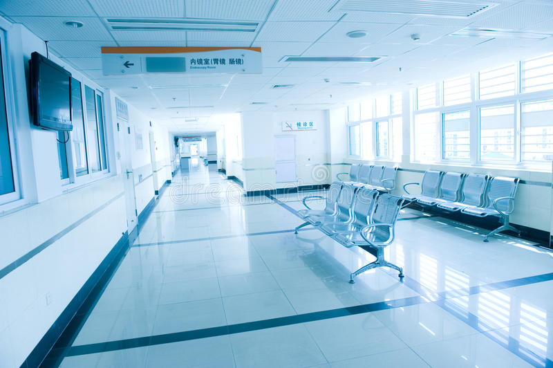Hospital waiting room. Blue tone of hospital waiting room with empty chairs royalty free stock photos