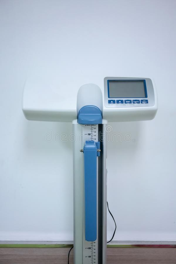 Hospital weighing scale with digital screen for height and weigh stock image