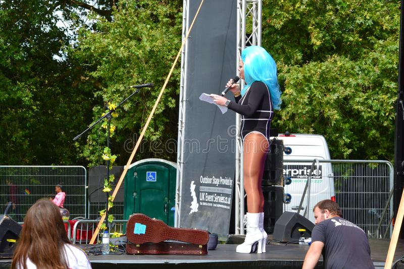 The host of the Reading Pride Parade 2019 holding a speech and opening the main stage. Reading, Berkshire, UK, England, 31st August 2019, People celebrating royalty free stock images