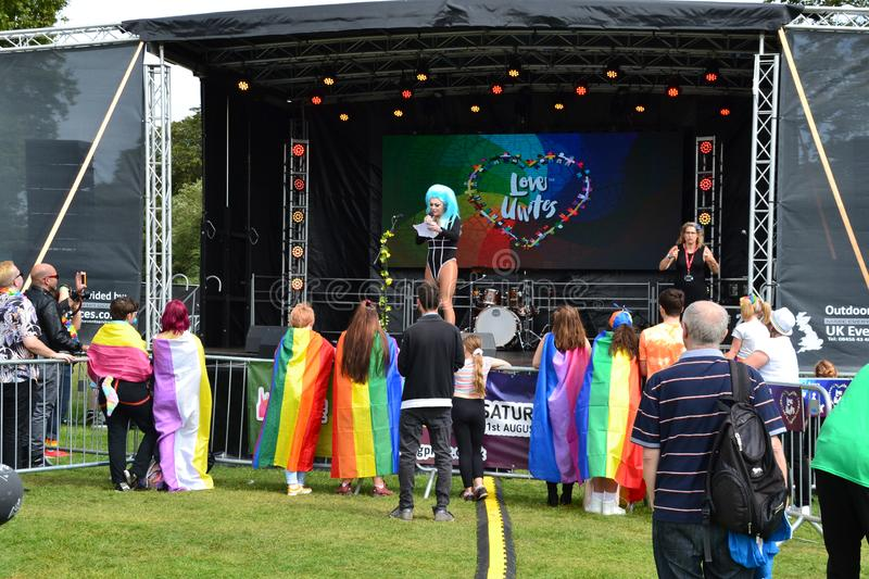 The host of the Reading Pride Parade 2019 holding a speech and opening the main stage. Reading, Berkshire, UK, England, 31st August 2019, People celebrating royalty free stock photos
