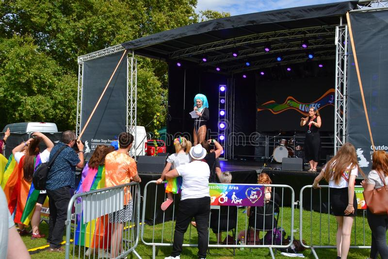 The host of the Reading Pride Parade 2019 holding a speech and opening the main stage. Reading, Berkshire, UK, England, 31st August 2019, People celebrating stock photography