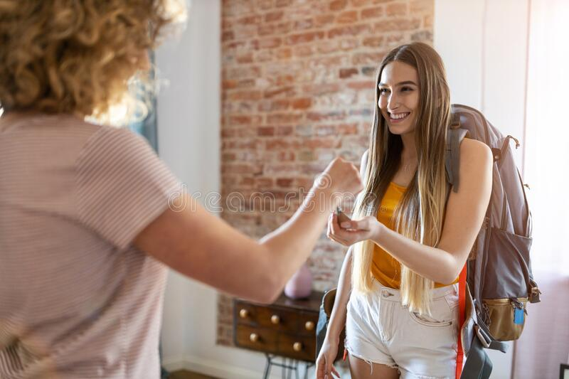 Young female backpacker renting apartment stock photography