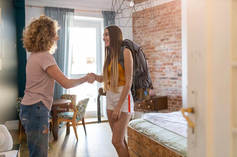 Young female backpacker renting apartment stock photos