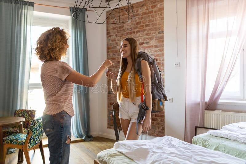 Young female backpacker renting apartment royalty free stock image