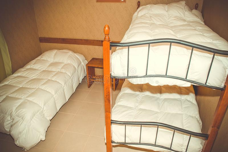 Hostel, small room, bunk beds royalty free stock images