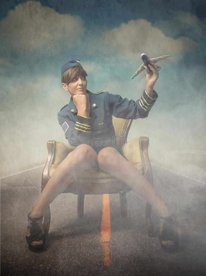 Hostess with airplane on hand. Textured and foggy background stock photos