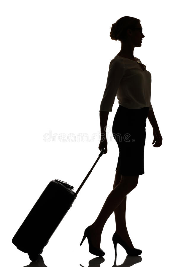 Hostess business class travel silhouette studio shot. On white royalty free stock images