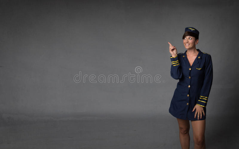 Hostess indicated with finger. Copyspace stock photography