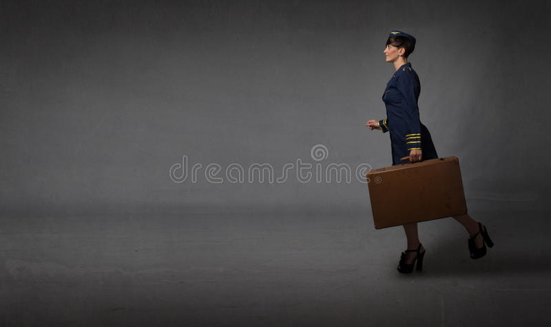 Hostess running in an empty room stock photos