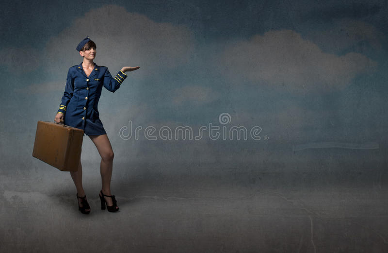 Hostess showing empty sky. Textured background royalty free stock photo
