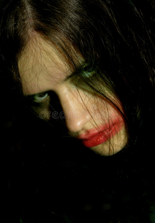 Hostile look of a young woman with psychical problems.  royalty free stock photos
