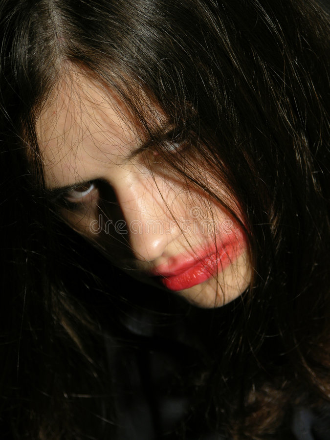 Hostile look of a young woman with psychical problems.  royalty free stock images