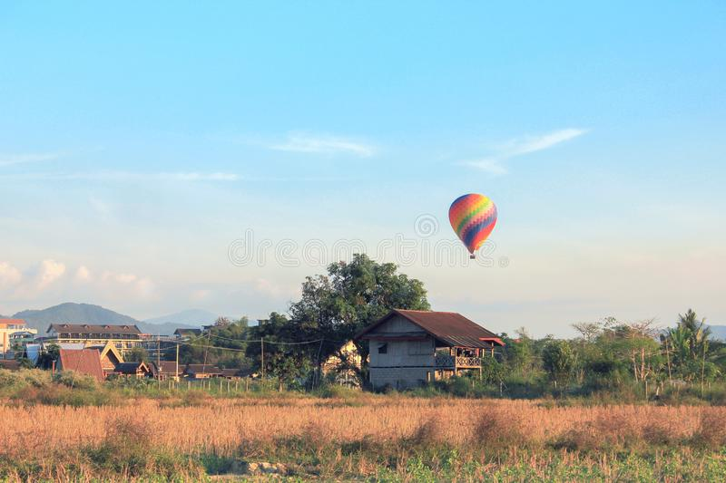 Hot Air Ballon in a Countryside Landscape royalty free stock photo
