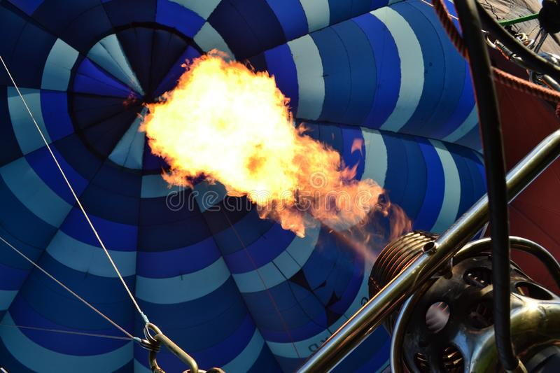 A hot air ballon filled with fire nozzles. Detail on the inside of the hot air balloon when climbing, fire nozzles in the process stock images