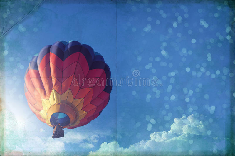 Hot air ballon paper texture, blue sky and light effect, vintage royalty free stock photography