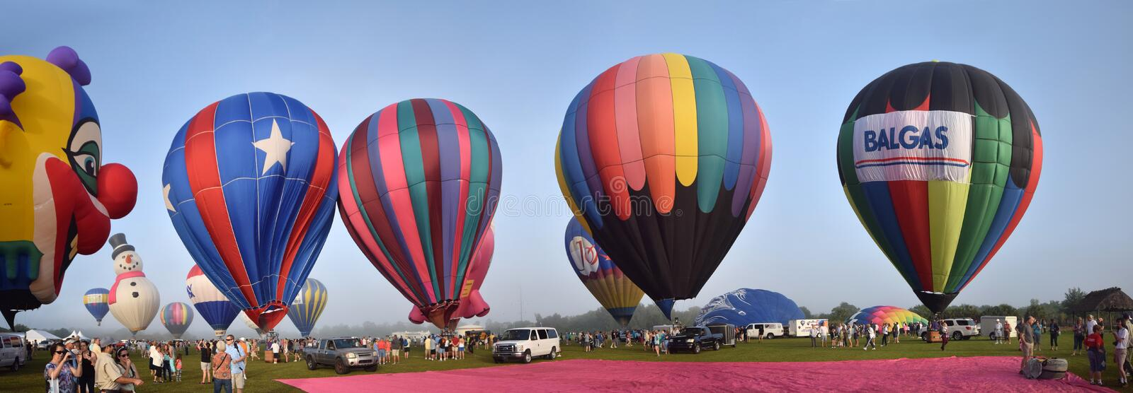 Hot air ballons in early morning panoramic view stock images